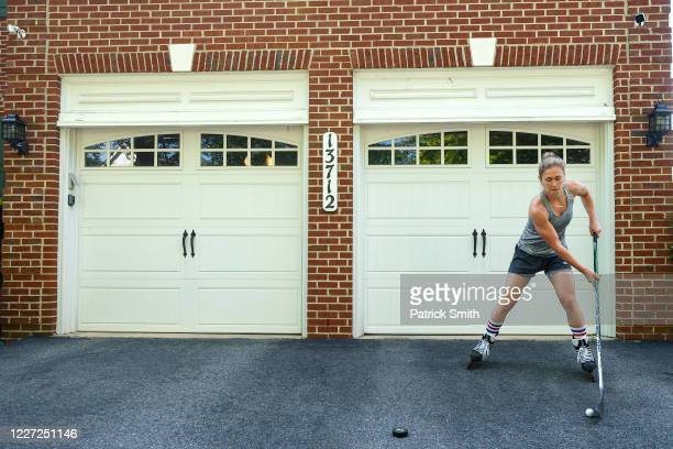 Team USA Olympic Women's Hockey Gold Medalist Haley Skarupa performs stickhandling drills in her driveway during a training session at her home on...