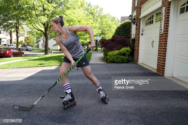 Team USA Olympic Women's Hockey Gold Medalist, Haley Skarupa performs stick-handling drills in her driveway during a training session at her home on...