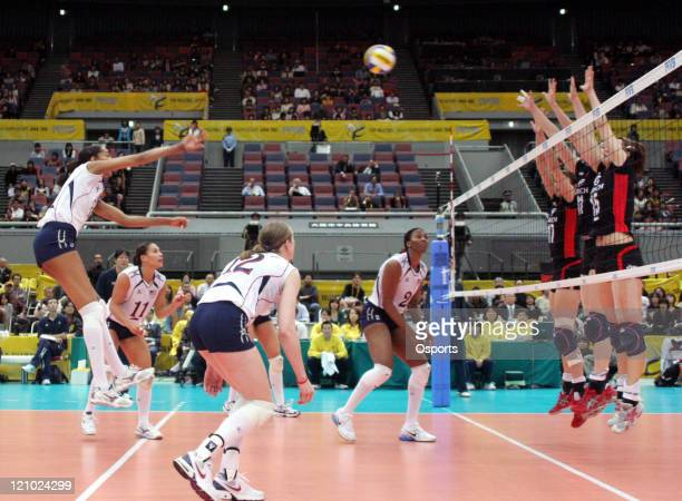 A Team USA player hits a smash versus Germany in the second round at the Women's Volleyball World Championship Osaka Japan November 12 2006 The USA...