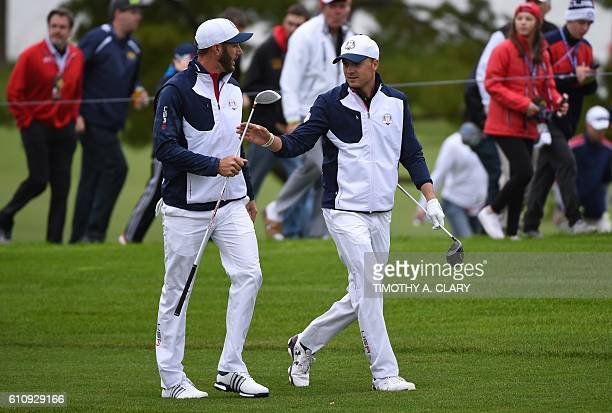 Team USA player Jordan Spieth and Dustin Johnson walk during a practice round aheadof the 41st Ryder Cup at Hazeltine National Golf Course in Chaska...