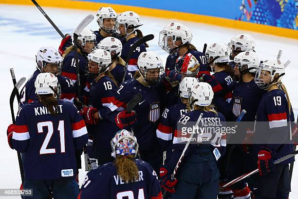 Team USA players celebrate after the Women's Ice Hockey Preliminary Round Group A game on day three of the Sochi 2014 Winter Olympics at Shayba Arena...