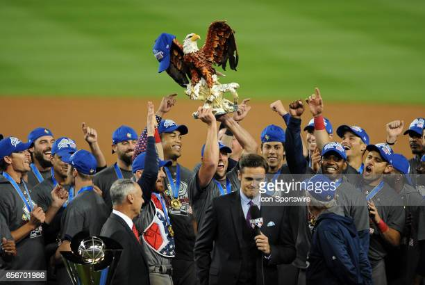 Team USA players with a bald eagle statue on the field after defeating team Puerto Rico 8 to 0 on March 22 to become the 2017 World Baseball Classic...