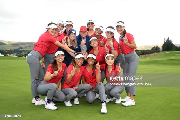 Team USA pose for a photograph with the Trophy after they win the PING Junior Solheim Cup during Preview Day 3 of The Solheim Cup at Gleneagles on...