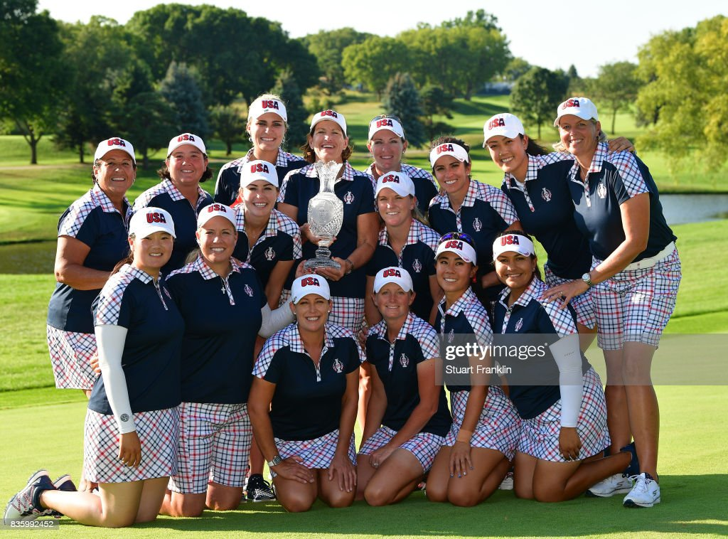 Team USA pose with the Solheim Cup trophy after the final day singles matches of The Solheim Cup at Des Moines Golf and Country Club on August 20, 2017 in West Des Moines, Iowa.