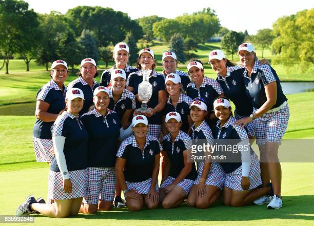 Team USA pose with the Solheim Cup trophy after the final day singles matches of The Solheim Cup at Des Moines Golf and Country Club on August 20...
