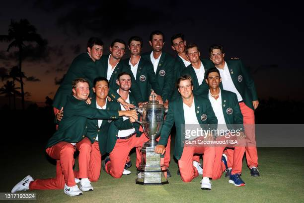Team USA poses with the trophy after defeating Team Great Britain and Ireland 14-12 on Day Two of The Walker Cup at Seminole Golf Club on May 09,...