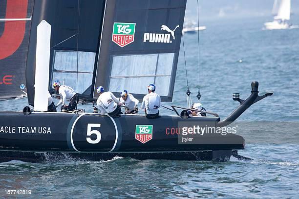 team usa racing catamaran - catamaran race stock photos and pictures