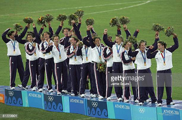 Team USA receive the Gold medal in women's football after beating Brazil 21 in extra time on August 26 2004 during the Athens 2004 Summer Olympic...