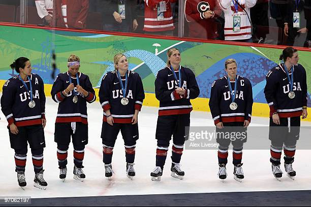 Team USA receive their silver medals in the medal ceremony following the ice hockey women's gold medal game between Canada and USA on day 14 of the...