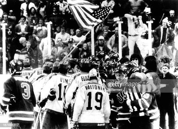 Team USA shakes hands with Team Finland after their 42 victory in the Gold Medal Men's Ice Hockey event at the 1980 Winter Olympic Games in Lake...