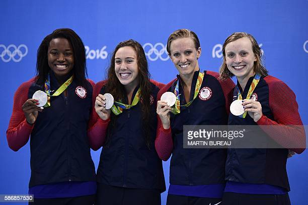 Team USA Simone Manuel Abbey Weitzeil Dana Vollmer and Katie Ledecky pose with their silver medals on the podium of the Women's 4 x 100m Freestyle...