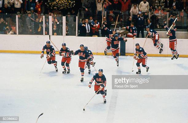 Team USA skates to the middle of the rink to celebrate winning another game during the XIII Olympic Winter Games in February of 1980 in Lake Placid,...