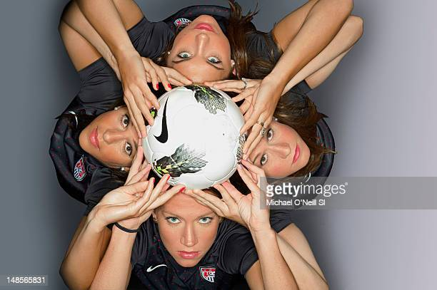 Team USA soccer players Alex Morgan Heather O'Reilly Lauren Cheney and Carli Lloyd pose for the Sports Illustrated Summer 2012 Olympic portfolio on...