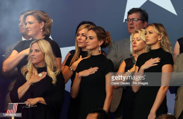 Team USA teams wives and girlfriends Amy Mickelson Jena Sims and Paulina Gretzky during the Ryder Cup Opening Ceremony at Le Golf National...