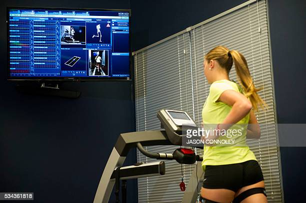 TOPSHOT Team USA triathlete Erin Jones wears monitors providing information for a Noraxon gait analysis during her training run at the US Olympic...