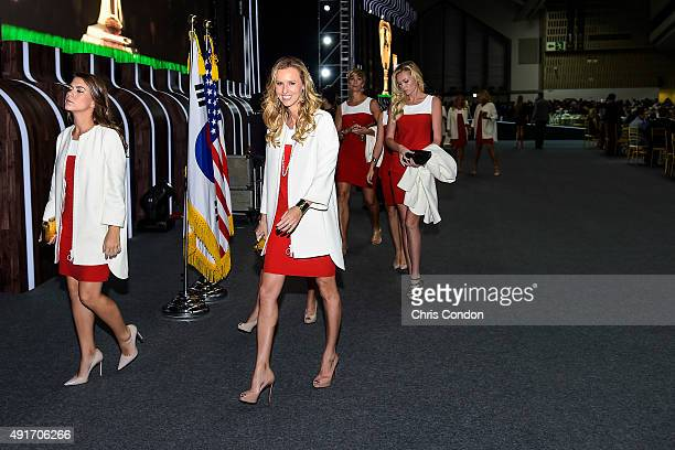 Team USA wives and girlfriends Annie Verret Erin Walker Angie Watson and Paulina Gretzky leave following The Presidents Cup Opening Ceremony at...