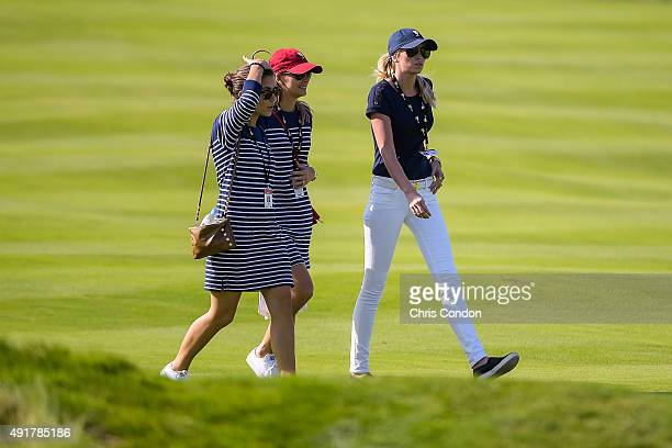 Team USA wives and girlfriends Annie Verret Tahnee Kirk and Paulina Gretzky follow play during the first round of The Presidents Cup at Jack Nicklaus...