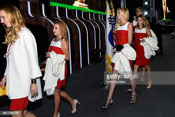 Team USA wives and girlfriends Erin Walker Erica Holmes Paulina Gretzky Tahnee Kirk and Angie Watson leave following The Presidents Cup Opening...