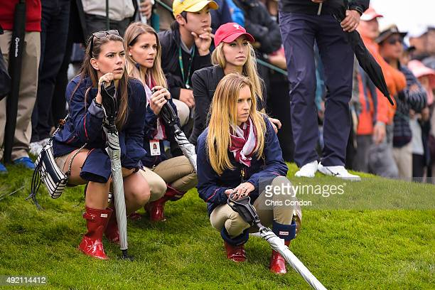 Team USA wives and girlfriends from left Annie Verret Tahnee Kirk and Erin Walker follow play during morning foursomes in the third round of The...