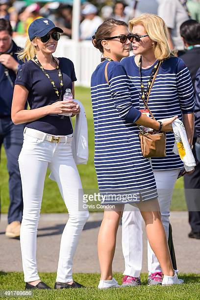 Team USA wives and girlfriends Paulina Gretzky Annie Verret and Jan Haas watch play on the first hole tee box during the first round of The...