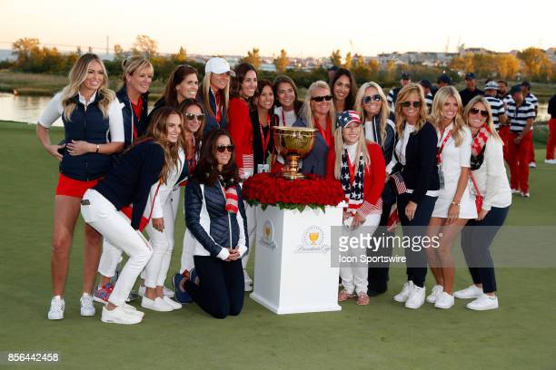 Team USA wives and girlfriends pose for a group photo after the final round of the Presidents Cup at Liberty National Golf Club on September 30 2017...