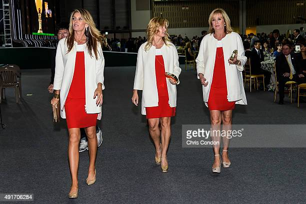 Team USA wives and girlfriends Suzanne Hannemann Tabitha Furyk and Jan Haas leave following The Presidents Cup Opening Ceremony at Songdo Convensia...