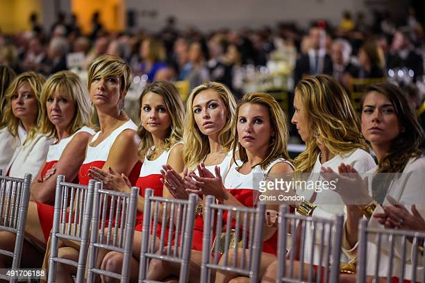 Team USA wives and girlfriends Tabitha Furyk Robin Love Angie Watson Tahnee Kirk Paulina Gretzky Erica Holmes Erin Walker and Annie Verret applaud...