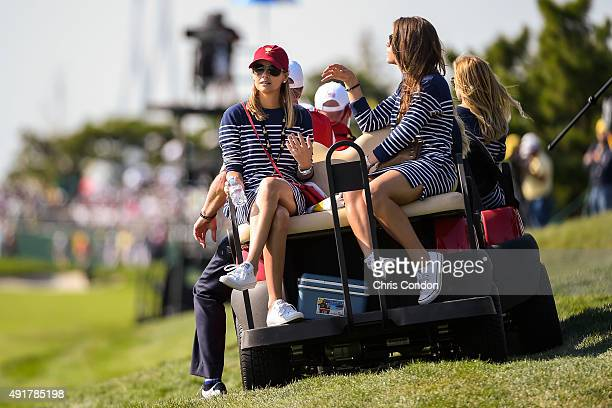 Team USA wives and girlfriends Tahnee Kirk and Annie Verret follow play during the first round of The Presidents Cup at Jack Nicklaus Golf Club Korea...