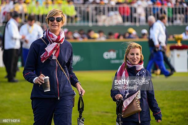 Team USA wives Angie Watson left and Erica Holmes watch play during morning foursomes in the third round of The Presidents Cup at Jack Nicklaus Golf...