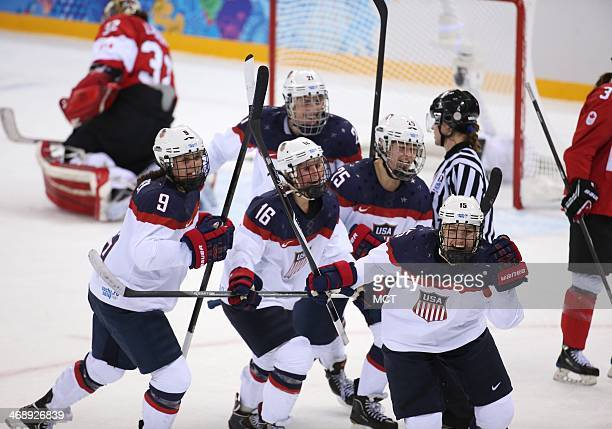 Team USA's Anne Schleper leads the celebration after she assisted on a goal scored by Hilary Knight against Canada in the second period of a women's...
