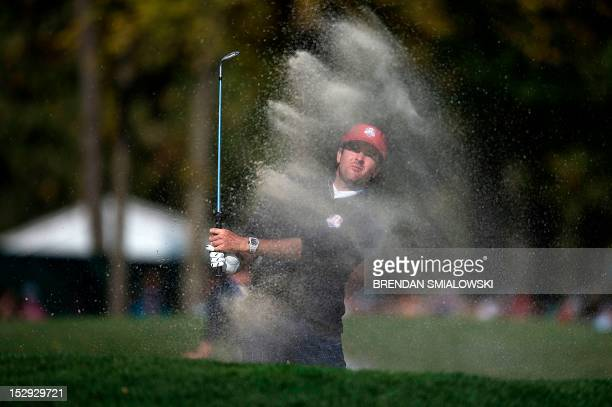 Team USA's Bubba Watson hits out of a bunker on the 10th hole during the afternoon Four Ball Match on the first day of the 39th Ryder Cup at the...