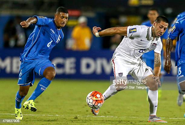 Team USA's Clint Dempsey tries to get a loose ball from Honduras' Bryan Acosta during the first half of a CONCACAF Gold Cup soccer match on Tuesday...