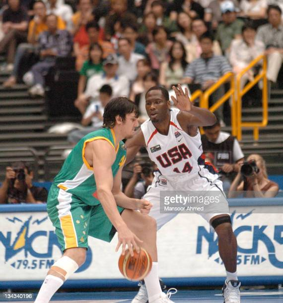Team USA's Elton Brand defends an Australian forward during the Final Eight round of the 2006 FIBA World Championships at Saitama Super Arena Tokyo...