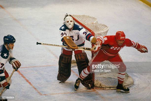 Team USA's goalie Jim Craig clears the side of the net obstructed by a team Russia player during the XIII Olympic Winter Games in February of 1980 in...