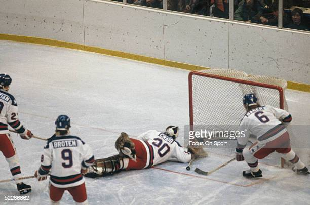 Team USA's goalie Jim Craig slides to guard the net but lets a puck by during the XIII Olympic Winter Games in February of 1980 in Lake Placid New...