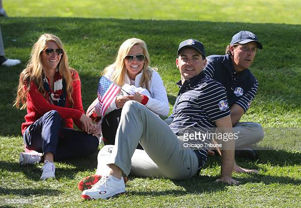 Team USA's Keegan Bradley 2nd from right and teammate Phil Mickelson right watch the action with Phil's wife Amy Mickelson center and Keegan...