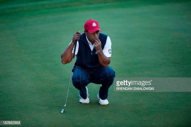 Team USA's Tiger Woods line up a put on the 18th hole's green during the afternoon Four Ball Match on the first day of the 39th Ryder Cup at the...
