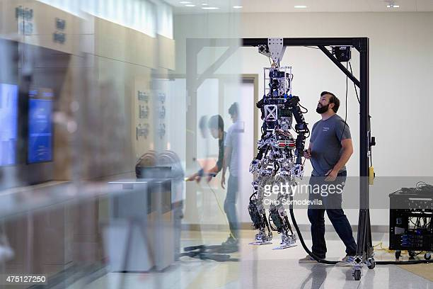 Team Valor member John Seminatore tests the THOR robot while readying for the Defense Advanced Research Projects Agency Robotics Challenge at the...