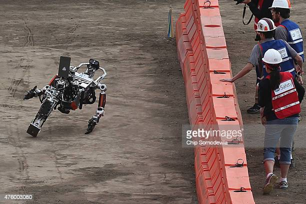 Team Valor's semiautonomous ESCHER robot lays on the ground after falling backwards during its first run during the Defense Advanced Research...