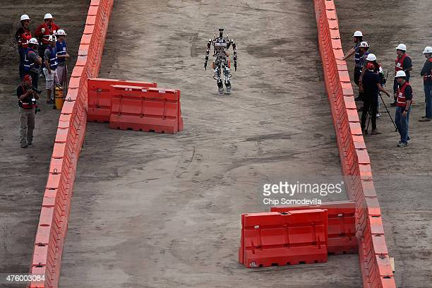 Team Valor's semiautonomous ESCHER robot walks through the 'slalom' section of the Defense Advanced Research Projects Agency Robotics Challenge at...