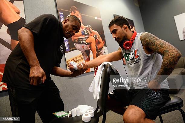 Team Velasquez fighter Jose Alberto Quinonez gets his hands wrapped in the locker room before facing teammate Marco Beltran in their semifinal fight...