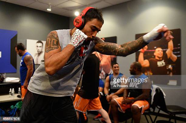 Team Velasquez fighter Jose Alberto Quinonez warms up in the locker room before facing teammate Marco Beltran in their semifinal fight during filming...