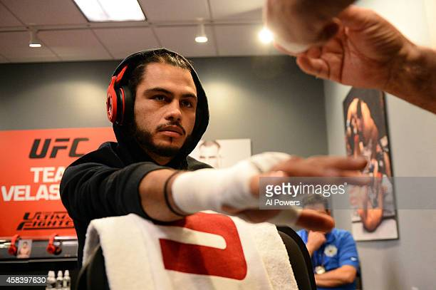 Team Velasquez fighter Marco Beltran gets his hands wrapped in the locker room before facing teammate Jose Alberto Quinonez in their semifinal fight...