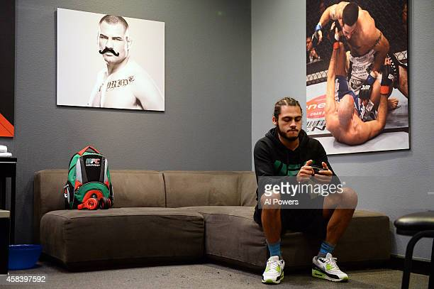 Team Velasquez fighter Marco Beltran sits in the locker room before facing teammate Jose Alberto Quinonez in their semifinal fight during filming of...