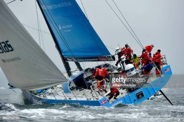Team Vestas 11th Hour Racing keep busy after making a tack at the Volvo Ocean Race's Gurney's Resorts InPort Race on May 19 2018 in Newport Rhode...
