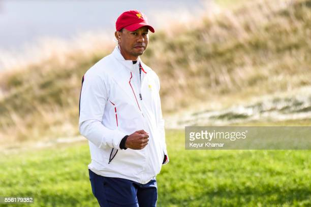 S Team Vice Captain Tiger Woods celebrates after Patrick Reed not shown hit a shot from the 17th hole fairway during Saturday afternoon FourBall...