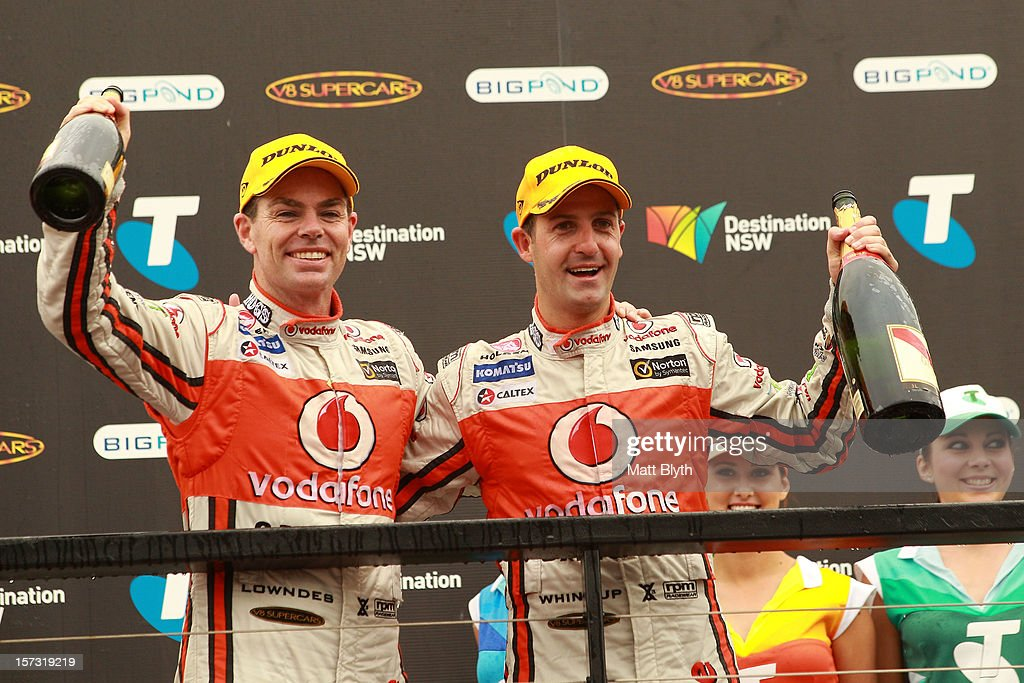 Team Vodafone Holden drivers Craig Lowndes and Jamie Whincup celebrate on the podium after race 30 during the Sydney 500, which is round 15 of the V8 Supercars Championship Series at Sydney Olympic Park Street Circuit on December 2, 2012 in Sydney, Australia.
