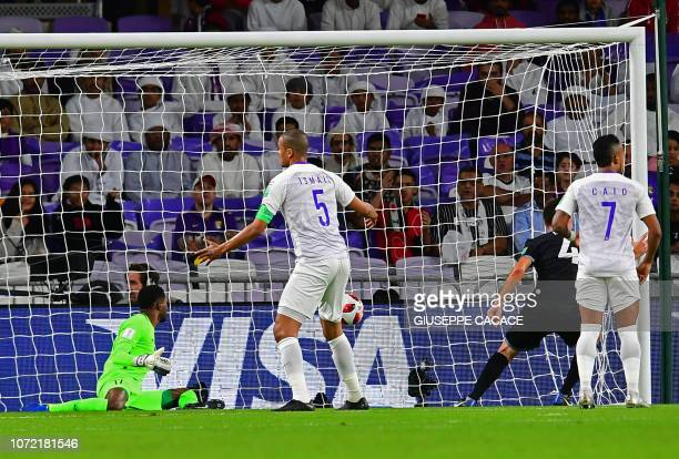 Team Wellington's midfielder Mario Ilich scores past AlAin's goalkeeper Khalid Eisa during the opening match of the FIFA Club World Cup 2018 football...