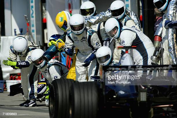 Team Williams pit crew prepare for a pit stop during the Italian Grand Prix at the Autodromo Nazionale di Monza on September 10 in Monza Italy