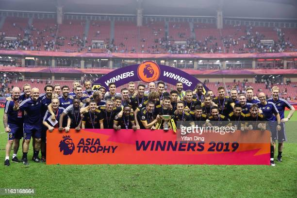 Team Wolverhampton Wanderers pose for a group shot during podium ceremony of Premier League Asia Trophy Final between Manchester City and...